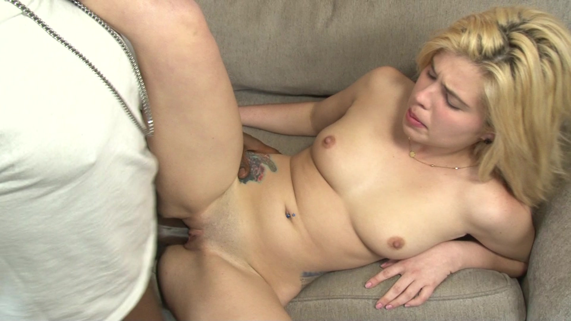 Blonde Cutie Fucks and Older Black Stud on the Gray Couch