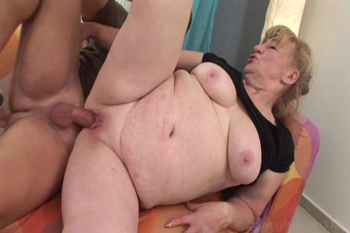 Big busty woman spreads her legs for a 9