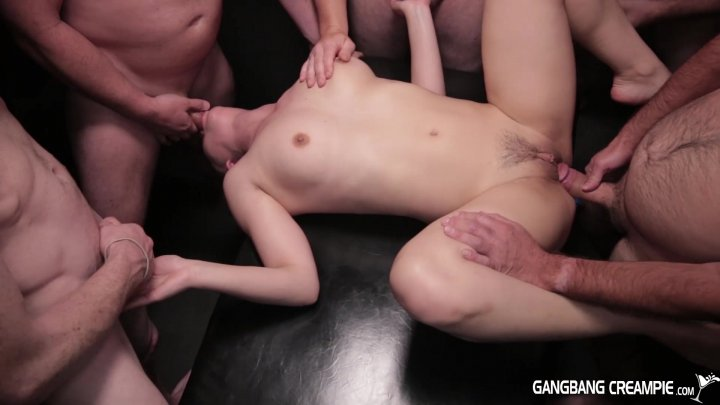 Taylor Sands Takes On Multiple Cocks in Gangbang Action porn video scene.