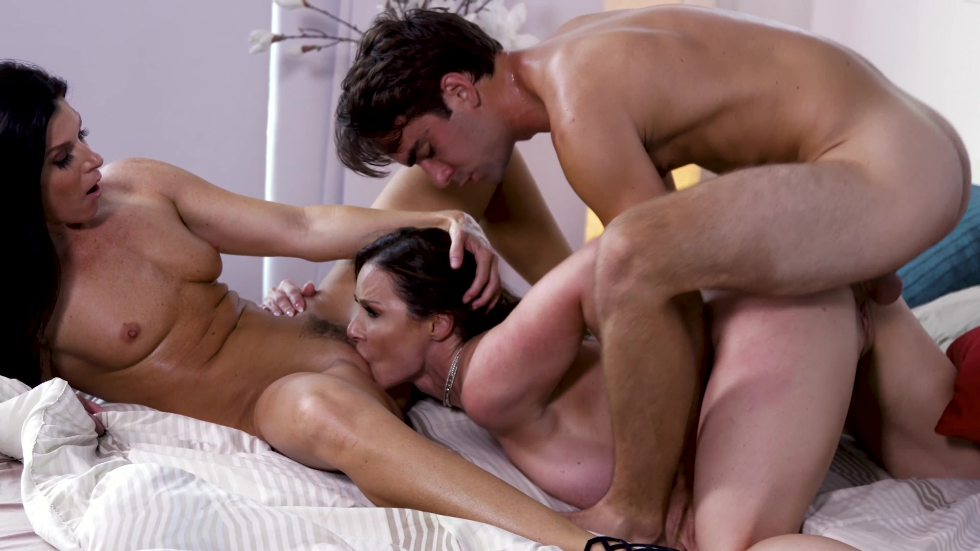 Kendra Lust and India Summer Have a Threesome with a Young Stud HD porn video scene.